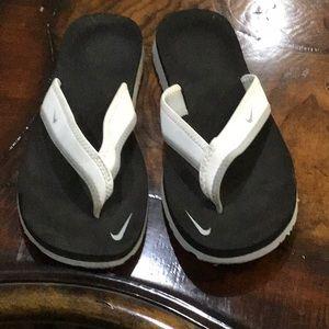 Nike flip flops size 7.